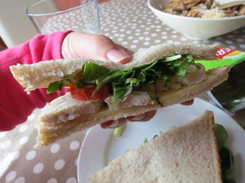 Enjoying salad (see lettuce and tomato) on my sandwich. No mayo.